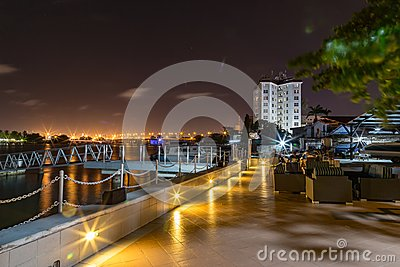 Lagos creeks at night with Victoria Island bridge in the distance