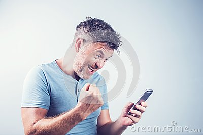 Handsome young man using mobile phone feel happy