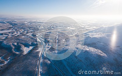 Aerial sunny winter view of Abisko National Park, Kiruna Municipality, Lapland, Norrbotten County, Sweden, shot from drone, with r