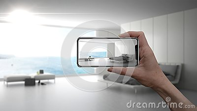 Hand holding smart phone, AR application, simulate furniture and interior design products in real home, architect designer concept