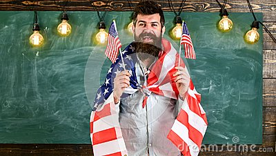 Patriotic education concept. Portrait of cheerful glad excited confident with toothy beaming smile student wearing denim