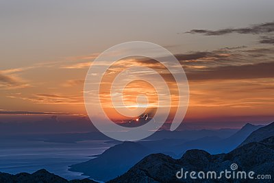 Sunset in Biokovo Nature Park with interesting luminous clouds, the Dalmatian coast and mountains in shades of blue, Sveti Jure