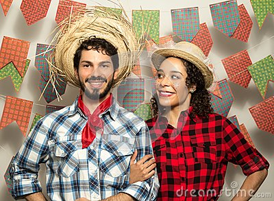 Festa Junina: party in Brazil. Man and woman dressing checked pa