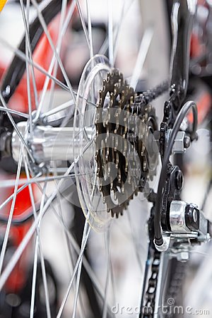 Bike speed changing assembly. Rear wheel. Steel bicycle chain. Transmission gears close-up
