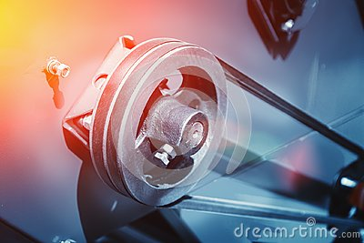 Industrial automotive machine tool equipment close up, abstract industry manufacturing metalwork background, toned