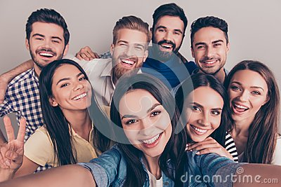 Cheers! Funky mood. Close up of an eight excited friend`s selfie