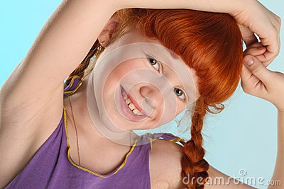 Close-up portrait of little redhead pre-teen fashion girl-model