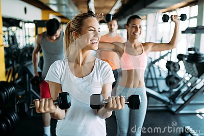 stock image of picture of two fitness women in gym