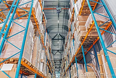 Large Logistics hangar warehouse with lots shelves or racks with pallets of goods. Industrial shipping