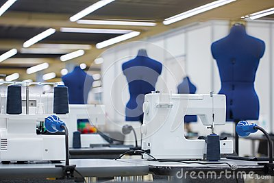 Interior of garment factory. Tailoring industry, fashion designer workshop, industry concept