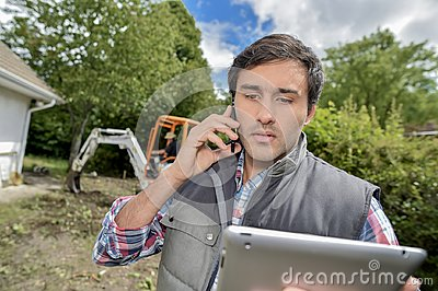 Landscaper on the phone