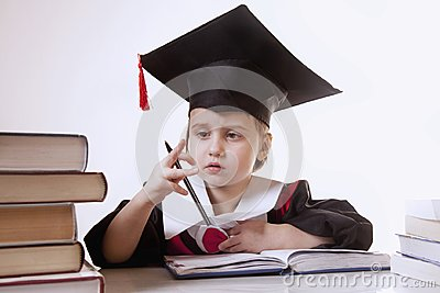 Child girl college graduate thinking about her perspectiv and future job. Humorous photo. (Knowledge, studies, work, career