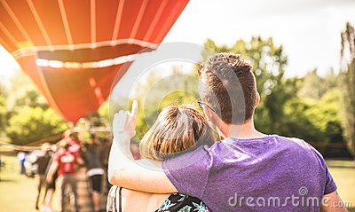 Happy couple in love on honeymoon excursion waiting for hot air