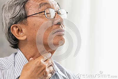 elder old man Sore throat irritation and have a phlegm hand touching neck