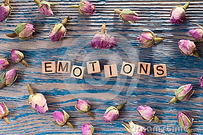 stock image of emotions on wooden cube
