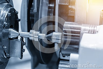 The CNC cylindrical grinding machine making the cam shaft