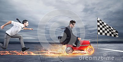 stock image of fast businessman with a car wins against the competitors. concept of success and competition