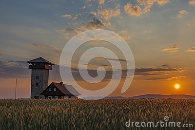 Color sunset near Roprachtice village with observation tower
