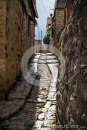Ancient streets in traditional town Deir el Qamar in vertical position, Lebanon