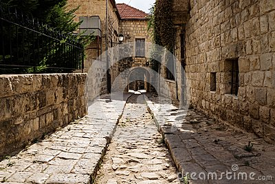Ancient streets with arch through house in traditional town Deir el Qamar, Lebanon