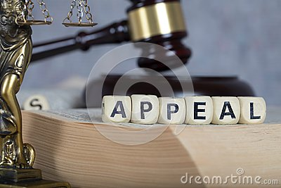 Word APPEAL composed of wooden letters.