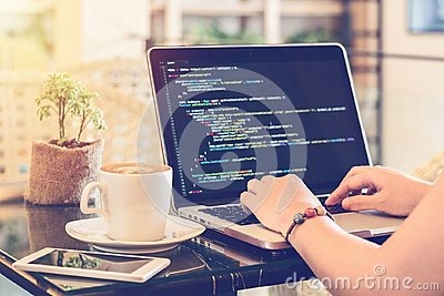 A programmer typing source codes in a coffee shop. Studying, Working, Technology, Freelance Work, Web Design Business concepts.