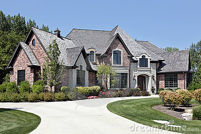 Large brick home with circular driveway