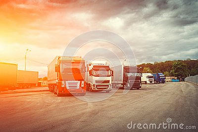 stock image of logistic and transport concept, container trucks for cargo delivery at sunset time, industrial transportation shipping
