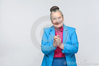 Cunning aged woman toothy smiling