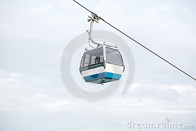 stock image of funicular or ropeway and public transport through gulf or river or channel in lisbon in portugal.