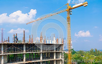 Construction workers site and building of housing at laborer work outdoor which has tower crane blue sky background with copy sp