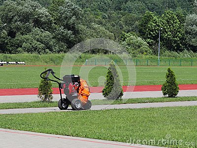 Adaptations for the care of lawns of football fields and stadiums. A machine that facilitates the manual labor of people. Preparat