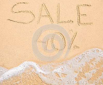 The word Sale 40% written in the sand on beach