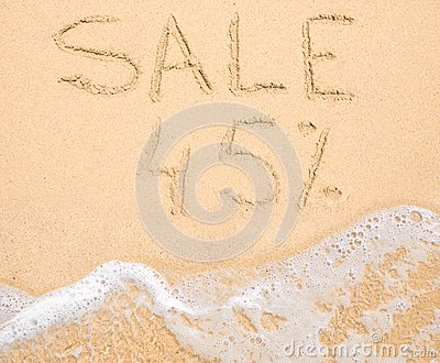 The word Sale 45% written in the sand on beach