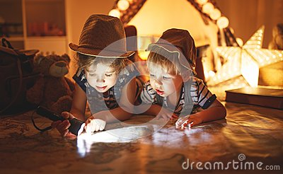Funny children   tourist with flashlight and world map and backp