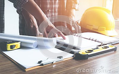 Architect engineer working concept and construction tools or safety equipment on table.