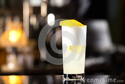 Closeup glass of gin fizz cocktail with lemon and whip eggwhite