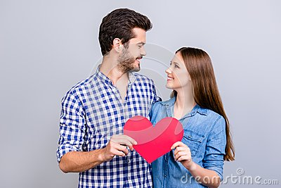 stock image of love story. trust and feelings, emotions and joy. happy young lovely couple in love is posing, wearing casual shirts, holding big