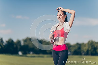 Well done! Attractive young sportwoman finished her work out and