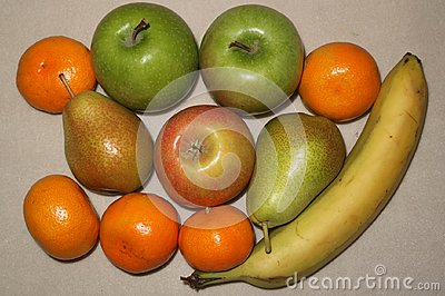 stock image of fruit background from apples, bananas and tangerines on designed.