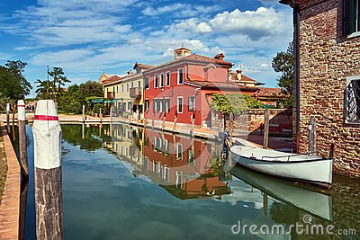 Torcello, Venice. Colorful houses on Torcello island, canal and