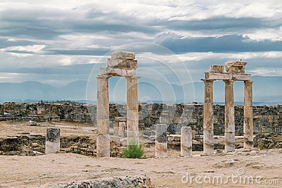 The ancient destroyed city of Hierapolis near Pamukkale, Denizli, Turkey in the summer. On a background the sky in overcast. Horiz