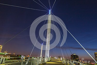 Night scene of Omaha Kerrey suspension bridge tower with suspension cables with beautiful sky colors just after sunset