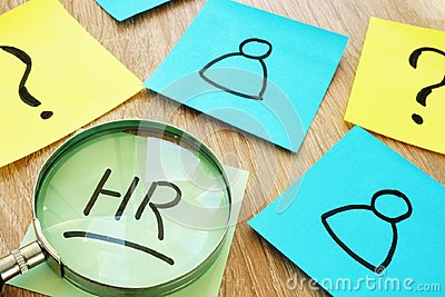 HR human resource written on a stick and magnifier.