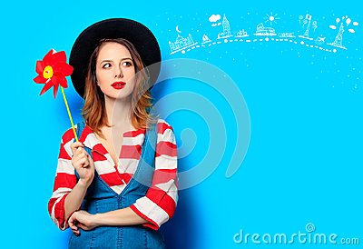 Woman with red pinwheel with travel route