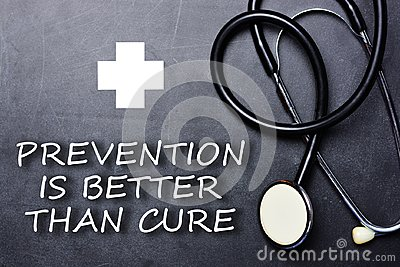 Prevention is better than cure text on chalkboard near medical object and symbols