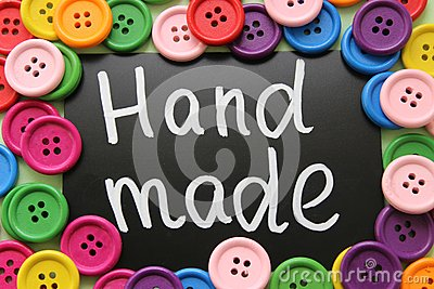 Chalk Board with the inscription `manual discount` surrounded by colorful wooden buttons