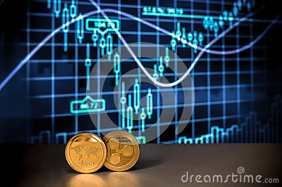 Cryptocurrency Financial Charts and Graphs with two golden XRP crypto coins of Ripple Cryptographic Currency