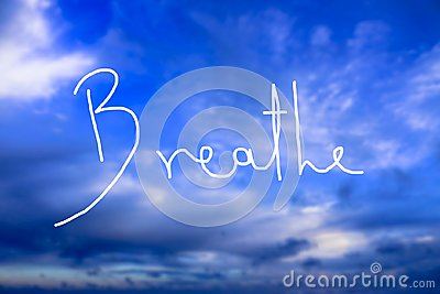 Breathe Handwritten logo in the sky