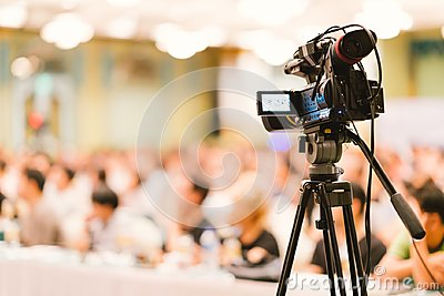 Video camera set record audience in conference hall seminar event. Company meeting, exhibition convention center concept